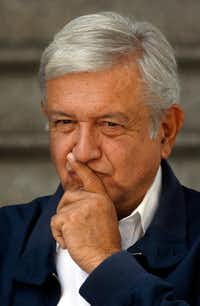 Mexico's President-elect Andres Manuel Lopez Obrador paused as he met with media outside his party's headquarters in Mexico City July 22. Lopez Obrador will meet with authorities and members of Juarez's civil society Tuesday as part of several peace and reconciliation forums across Mexico.  (Marco Ugarte/AP)