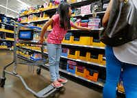 Isis Pangelinan shops for back-to-school materials at Walmart at Timber Creek Crossing in Dallas in 2017.(Nathan Hunsinger/File Photo)