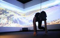 Student Tara Baker interacts with a virtual reality piece developed by David Stout.(Andy Jacobsohn/Staff Photographer)