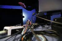 "David Stout, a composer and visual artist working with emerging technologies, controls a piece titled ""The Janus Switch"" with an infrared sensor, percussion controller and other technologies. (Andy Jacobsohn/Staff Photographer)"