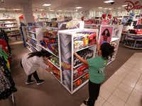 Employees straighten up the toy section at the Collin Creek Mall J.C. Penney in Plano.(Jason Janik/Special Contributor)