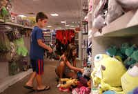 Mason Watson, 7, and 12-year-old Avery Watson check out the new toys at the Collin Creek Mall J.C. Penney in Plano.(Jason Janik/Special Contributor)