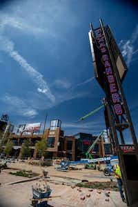 Construction crews finish the exterior of the Texas Live! entertainment venue, with Texas Rangers branding, in Arlington.(Brandon Wade/Special Contributor)