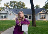 Lauren Alvarez says her travails with a Texas concrete company illustrate how difficult it can be to find a reliable home contractor. Along with her husband, she's a professional house flipper. Here, she stands in front of her renovated Colleyville home.(Rex C Curry/Special Contributor)