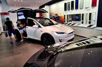 Board members at Tesla are evaluating CEO and Chairman Elon Musk's $72 billion proposal to take the electric car and solar panel maker private. Six of nine members said in a prepared statement Wednesday that Musk began talking with the board about the move last week. (Richard Vogel/The Associated Press)