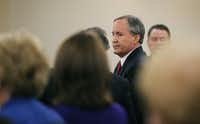 Texas Attorney General Ken Paxton leaves court at the conclusion of his hearing on his felony securities indictment, Thursday, Aug. 27, 2015, in Fort Worth. Paxton pleaded not guilty to charges alleging that he defrauded investors before he became the state's top lawyer, and his attorney Joe Kendall announced that he would no longer represent him.  (Star-Telegram/Rodger Mallison via AP, Pool) (Rodger Mallison/AP)