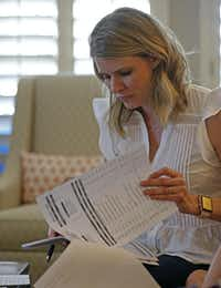 Kasey Woleben looks at a medical bill in the living room at her home in McKinney, Texas, Wednesday, June 20, 2018. (Jae S. Lee/Staff Photographer)