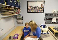 Occupational Therapy specialist Julie Bayless works with Will at Keystone Pediatric Therapy in McKinney, Texas, on June 20, 2018.(Jae S. Lee/Staff Photographer)