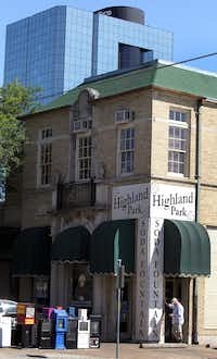 A modern building looms behind the Highland Park Soda Fountain, which celebrates its 100th anniversary in 2012, photographed on Sunday, April 22, 2012.  (Louis DeLuca/The Dallas Morning News)   --  (EDITOR'S NOTE: in 2010 the name changed from Highland Park Pharmacy to the Highland Park Soda Fountain).(Louis DeLuca/Staff Photographer)