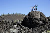 Visitors climb the natural formations at the Newberry National Volcanic Monument in Deschutes National Forest near Sunriver, Ore. (2014 File Photo/Chicago Tribune)