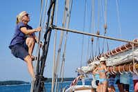 First mate Christa Miller-Shelley nears the top of the rigging on the starboard side of the American Eagle. (Robert N. Jenkins/Special Contributor)