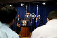 Acting Associate Attorney General Jesse Panuccio (center) takes a question from the media during a news conference on fraud on July 11, 2018, at the Department of Justice in Washington. With him are U.S. Securities and Exchange Commission Chairman Jay Clayton (left) and Mick Mulvaney, acting director of the Consumer Financial Protection Bureau and director of the Office of Management.(Jacquelyn Martin/The Associated Press)