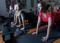 From left: Andrew Falcinelli, Alex Fox, Amanda Dunnavant and Ann Ryan participate in a stretching and meditation class at the Refuge  Meditation on Friday.(Rex C. Curry/Special Contributor)