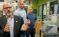 """<p><span style=""""font-size: 1em; background-color: transparent;"""">University of North Texas chemistry professor Guido Verbeck (left) talks about a breathalyzer that will test for drugs, as Tim Wing, InspectIR co-founder/managing director (center) and UNT graduate student Tom Kiselak (right) listen.</span></p>(Louis DeLuca/Staff Photographer)"""