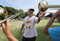 Woodrow Wilson band director Chris Evetts gets a student to raise their instrument higher during band practice . (Vernon Bryant/Staff Photographer)