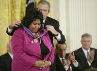 President George W. Bush presents Aretha Franklin with the Presidential Medal of Freedom, the nation's highest civilian award, in the East Room of the White House in Washington, D.C., on Nov. 9, 2005.(Douglas A. Sonders/Getty Images)