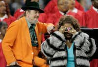 Singer Aretha Franklin takes a picture during the national anthem prior to the start of Super Bowl XL between the Seattle Seahawks and the Pittsburgh Steelers at Ford Field on Feb. 5, 2006, in Detroit. Behind her is singer Dr. John.(Brian Bahr/Getty Images)
