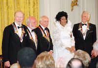 The recipients of the 1994 Kennedy Center Honors award  attend a reception Sunday evening, Dec. 4, 1994, in the East Room  of the White House. From left are songwriter Pete Seeger,  director Harold Prince, composer Morton Gould, singer Aretha  Franklin, and actor Kirk Douglas.(Doug Mills/The Associated Press)