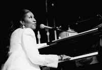 In July 1992, Aretha Franklin sang the national anthem at a tribute for Jesse Jackson at the Apollo Theater in Harlem. It was the start of weeklong events for the 1992 Democratic National Convention in New York City, in which Arkansas Gov. Bill Clinton would accept the party's nomination.(Irwin Thompson/The Dallas Morning News)