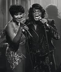 Soul singers James Brown and Aretha Franklin sing during a HBO taping at the Taboo night club in Detroit in January 1987.(Joe Kennedy/The Associated Press)