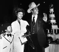 Aretha Franklin and her new husband, Glynn Turman, arrive at a Los Angeles hotel, April 17, 1978, for their wedding reception. Turman signals his OK and pleasure at the reception as Aretha's son Kecalf, 8, by a previous marriage, looks on. The couple married recently and had planned a reception at her Beverly Hills home on Saturday, but the party was rained out and moved to the hotel for Sunday.(Doug Pizac/The Associated Press)