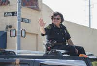 Dallas County Sheriff Lupe Valdez rode atop a Hummer in Garland's annual Labor Day Parade on Monday Sept. 7, 2015.    (Rex C. Curry/Special Contributor)(Rex C. Curry/Special Contributor)