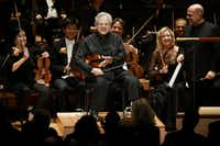 Violin soloist Itzhak Perlman receives a standing ovation from the audience before playing during the Dallas Symphony Orchestra's Gala Concert in 2014.(Andy Jacobsohn/Staff Photographer)