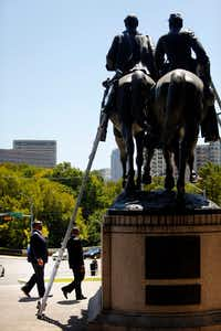 Dallas Councilman Dwaine Caraway (left) came to see the Robert E. Lee statue before it was removed from Robert E. Lee Park in Dallas.(Tom Fox/Staff Photographer)