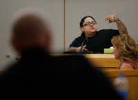 Monique Arredondo showed where Roy Oliver (foreground) had his gun after a vehicle accident she had with him while he was off-duty during a hearing for his trial at the Frank Crowley Courts Building in Dallas on Tuesday.(Rose Baca/Staff Photographer)