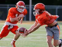 Jake Urbanowski (right) receives a pass while Parker Holman defends while taking part in a drill during the first week of football practice for Celina High School at Bobcat Stadium on Wednesday, August 8, 2018.(Stewart F. House/Special Contributor)
