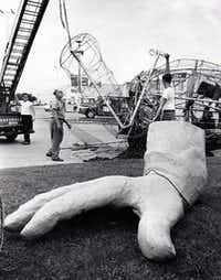 File photo of Big Tex being dismantled at the end of the 1970 State Fair season.(Jim Work/The Dallas Morning News)