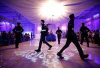 "<p></p><p>The Latin Boyz Cadets dancing group perform el vals, or <em style=""font-size: 1em; background-color: transparent;"">quinceañera</em><span style=""font-size: 1em; background-color: transparent;""> waltz.</span></p>(Nathan Hunsinger/Staff Photographer)"