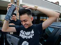 "<p>Gustavo Antunez perfects his pompadour hairstyle with hairspray before dancing at a <span style=""font-size: 1em; background-color: transparent;"">quinceañera.</span></p>(Nathan Hunsinger/Staff Photographer)"
