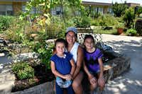 Parent and volunteer Maria Amaya, 36, with her daughters  Sophia Terry, 6, and Sarah Terry, 12, at the Edwin J. Kiest Elementary garden.(Ben Torres/Special Contributor)
