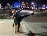"<p>Myra Watson silly-walks across the intersection at Main and Gilmer streets in downtown Sulphur Springs, Texas in March 2016.  (<span style=""font-size: 1em; background-color: transparent;"">Courtesy of Myra Watson.)</span></p>(Courtesy of Myra Watson)"