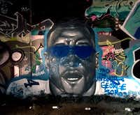 Blue glasses and other elements had been added on top of this image of Dak Prescott's face, originally painted Aug. 4 by artist Trey Wilder, on the graffiti art walls at Fabrication Yard in West Dallas.(Michael Hamtil/Staff photographer)