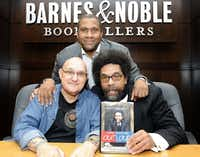 Biographer David Ritz, left, Tavis Smiley, top, and Dr. Cornel West at an October 2009 book signing in Los Angeles.  (EARL GIBSON III/AP)