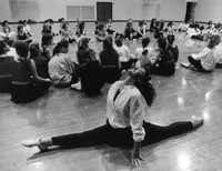 Nicole Vickerman of Plano's Clark High School limbered up during a drill team clinic. (1989 File Photo/Staff)