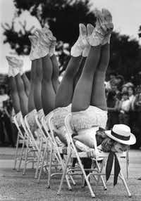Audrea Carroll and the rest of the Grand Prairie High School drill team performed a routine using folding chairs outside the Hall of State at the State Fair of Texas in 1984.(1984 File Photo/Staff)