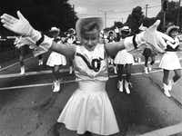 <p>Carolyn Sellers led the Sunset High School drill team in a parade on West Jefferson Boulevard to open the Old Oak Cliff tour of Homes and Arts festival in 1987.</p>(<p>1987 File Photo</p>/Staff)