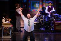 <p>Rob Collletti, who plays Dewey, performs with the cast in <i>School of Rock</i> at Fair Park Music Hall in Dallas.</p>(Ashley Landis/Staff Photographer)
