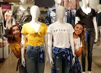 Twin sisters Bailey (left), and Brooklyn McKnight pose at an Arizona Jean Co. promotion inside J.C. Penney at Collin Creek Mall in Plano on Tuesday, July 11, 2018. The McKnight twins are part of J.C. Penney's national marketing plan for Arizona merchandise marketed for back-to-school clothing. The McKnight twins have a large fan base, with 5 million followers on YouTube and 3.3 million followers on Instagram. (Vernon Bryant/The Dallas Morning News)(Vernon Bryant/Staff Photographer)