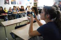 Rockwall High School student Emily Pettett uses her phone to text an answer to her AP psychology teacher Karen Miller. A few years ago, Rockwall tested out a program to bring electronic devices into learning.(2012 File Photo/Staff)
