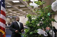 Council Member Dwaine Caraway looked  at plastic bags hanging from a plant during a City Council briefing meeting at Dallas City Hall on June 3, 2015. (File Photo/Staff )