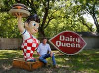 Gary Isett poses next to the Big Boy statue that's caused so much buzz about his lawn. Next to him is his 9-foot Dairy Queen sign, which he says is more unusual than McDonald's or Burger King signs. (Vernon Bryant/Staff Photographer)