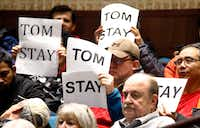 Supporters of Plano City Council member Tom Harrison hold up signs during a specially called public meeting on Feb. 18 at the Plano Municipal Center to discuss Harrison's anti-Islam social media post. (Tom Fox/Staff Photographer)