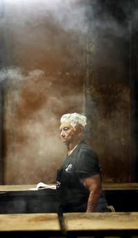 Tootsie Tomanetz makes her way between barbecue pits at Snow's BBQ. She begins work at 2 a.m. on Saturdays.(Vernon Bryant/Staff Photographer)