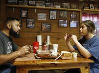 Pete and Dakota Rodriguez of Houston react after taking their first bite of a rib at Snow's BBQ. They arrived at 5 a.m. to be the first in line.(Vernon Bryant/Staff Photographer)