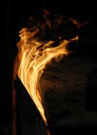 Flames rise out of a firebox at Snow's BBQ.(Vernon Bryant/Staff Photographer)