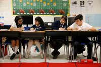 From left: Daniela Hernandez, Beatriz Ramirez, Briana Morales and Juan Pablo Ortiz work on math problems during class at Annie Webb Blanton Elementary in Dallas on May 17. Blanton Elementary is one of Dallas ISD's ACE schools where extra money and resources have been poured in to bolster struggling campuses.(Nathan Hunsinger/Staff Photographer)